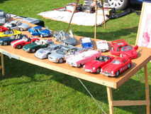 Model cars for sale. Model cars on a table for sale at a car boot sale. Car boot sales are very popular at weekends during the Summer months where people can Royalty Free Stock Images