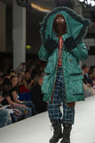 Model on a catwalk. Model walking on the catwalk in a fashion show in London on graduate fashion week Stock Image