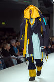 Model on a catwalk. Model walking on the catwalk in a fashion show in London on graduate fashion week Royalty Free Stock Photography