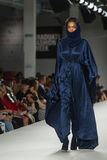 Model on a catwalk. Model walking on the catwalk in a fashion show in London on graduate fashion week Stock Photos