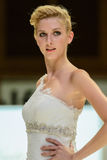 Model on catwalk wearing bridal gown Stock Images