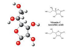 Model and  chemical formulas and  of ascorbic acid (vitamin C, E300) Royalty Free Stock Images