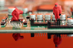 Model chemical team on a circuit board. Miniature scale model chemical team on a circuit board Stock Image