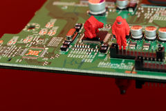 Model chemical team on a circuit board. Miniature scale model chemical team on a circuit board Stock Images