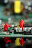Model chemical team on a circuit board Stock Photos