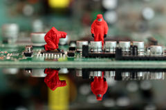 Model chemical team on a circuit board. Miniature scale model chemical team on a circuit board Stock Photography