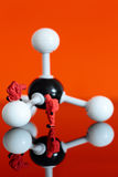 Model chemical team with a molecular model of methane Stock Photos