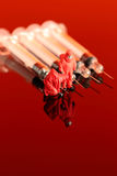 Model chemical team with syringes Royalty Free Stock Image