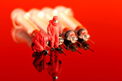 Model chemical team with syringes Stock Image