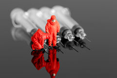 Model chemical team with syringes Royalty Free Stock Photography