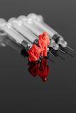 Model chemical team with syringes Stock Photo