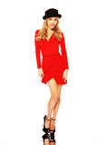 Model In Chic Red Outfit Displaying Legs. A beautiful blonde fashion model in chic red outfit showing off her long slim legs stock photo