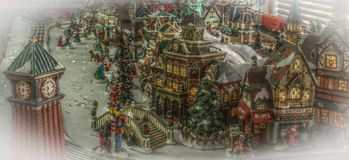 Model Chrismas Town and Train. Colorful model Chrismas town with snow, clocktower and train Royalty Free Stock Photography