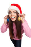 Model in christmas hat with decorative balls Stock Photos