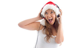Model with christmas hat and headphone Royalty Free Stock Photos