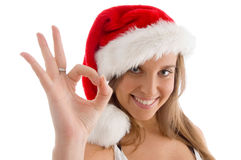 Model with christmas hat and showing ok sign Stock Photos