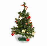 Christmas tree. The model of christmas tree that decorate by golden guitar, red bow and ball Royalty Free Stock Image