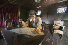 Model of Christopher Columbus at desk with map in his cabin at Muelle de las Carabelas, Palos de la Frontera - La R�bida, the Hu Royalty Free Stock Photography