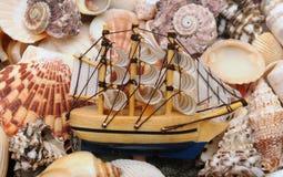 Model classic boat on sea shells Royalty Free Stock Image