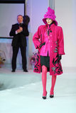 Model in coat and designer Slava Zaitsev. MOSCOW - NOVEMBER 4: Model in coat and designer Slava Zaitsev on left in fashion house of Slava Zaitsev on November 4 Royalty Free Stock Photography