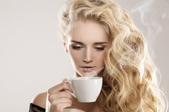 Model with coffee cup, mug in coffee shop. Fashion Woman, tea pa Stock Images