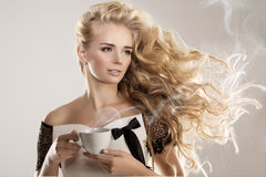 Model with coffee cup, mug in coffee shop. Fashion Woman, tea pa. Rty time. Greem Black. Blonde girl, tea set Royalty Free Stock Photos