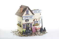 Model of Coffee Shop. And coins Royalty Free Stock Photo