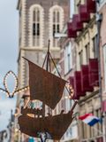 Model of a cog ship in the Oudestraat in Kampen, Netherlands. Model of a medieval cog ship in front of the Nieuwe Toren and the Gothisch Huis in the Oudestraat Stock Photo