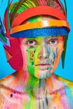 Model with colorful abstract makeup in multicolored helmet Stock Photo