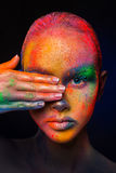 Model with colorful art make-up, close-up Stock Photography