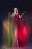 Model in colorful dress on black background Royalty Free Stock Photography