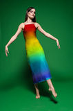 Model in colorful dress on green background Royalty Free Stock Photography