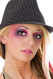 Model in colorful makeup. Blond female model wearing colorful hat and makeup Royalty Free Stock Image