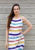 Model in colorful striped summer dress Stock Photo