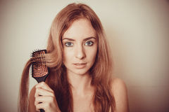 Model combing hair Royalty Free Stock Photography
