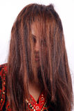 Model concealed by thick hair Royalty Free Stock Image