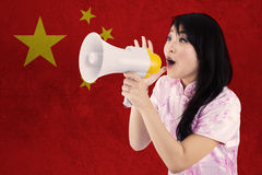 Model congratulate Chinese new year with megaphone Royalty Free Stock Photos