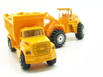 Model construction vehicles. Scale models representing construction vehicles isolated on white background Stock Photos
