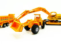 Model construction vehicles. Scale model toys that represent a construction vehicle such as an excavator, crane, truck, backhoe Stock Images