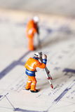 Model construction workers building plans C Royalty Free Stock Photography