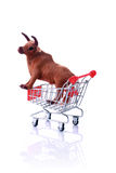 Model cow in shopping cart isolated on white Stock Photos