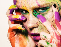 Model with creative makeup. Close-up portrait of young woman with unusual makeup. Model posing with paint drops over her face. Creative makeup Stock Photos