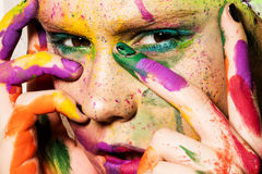 Model with creative makeup. Close-up portrait of young woman with unusual makeup. Model posing with paint drops over her face. Creative makeup Royalty Free Stock Images