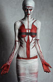Model with creative red and white body art Stock Photography