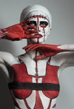 Model with creative red and white body art Royalty Free Stock Image
