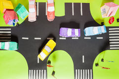 Model with crosswalks, signs, parking and toy cars Stock Photo