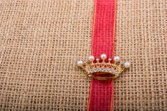 Model crown placed on a band on canvas Royalty Free Stock Photography