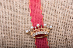 Model crown placed on a band on canvas Stock Image