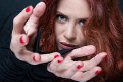 Model with curly hair doing a taking gesture Royalty Free Stock Photo