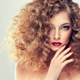 Model with curly hair Stock Images